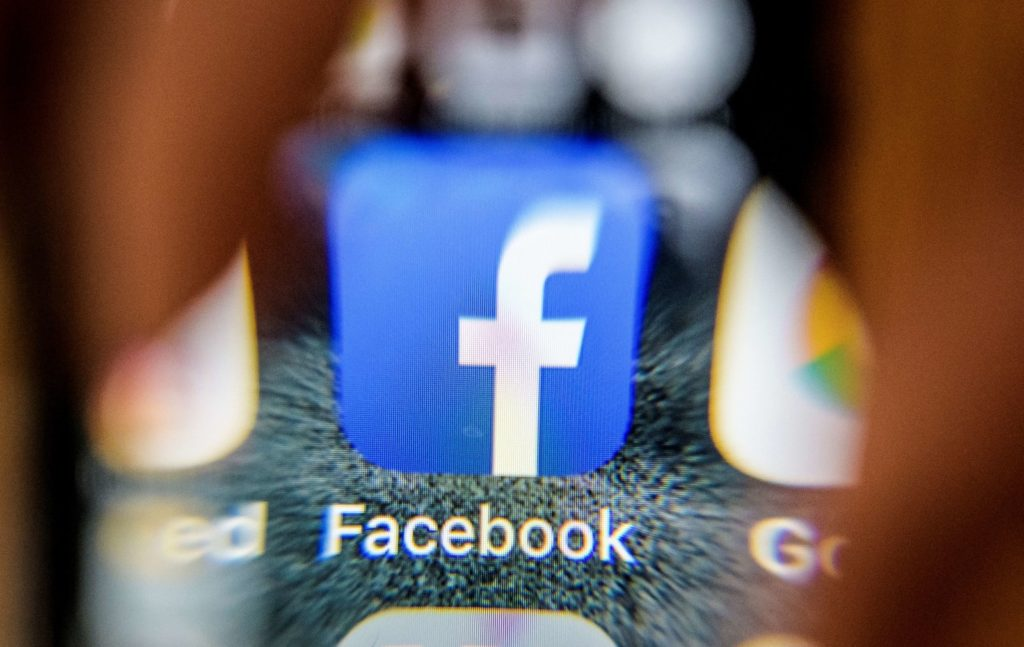 "An illustration picture taken through a magnifying glass on March 28, 2018 in Moscow shows the icon for the social networking app Facebook on a smart phone screen. Facebook said on March 28, 2018 it would overhaul its privacy settings tools to put users ""more in control"" of their information on the social media website. The updates include improving ease of access to Facebook's user settings, a privacy shortcuts menu and tools to search for, download and delete personal data stored by Facebook. / AFP PHOTO / Mladen ANTONOV        (Photo credit should read MLADEN ANTONOV/AFP/Getty Images)"
